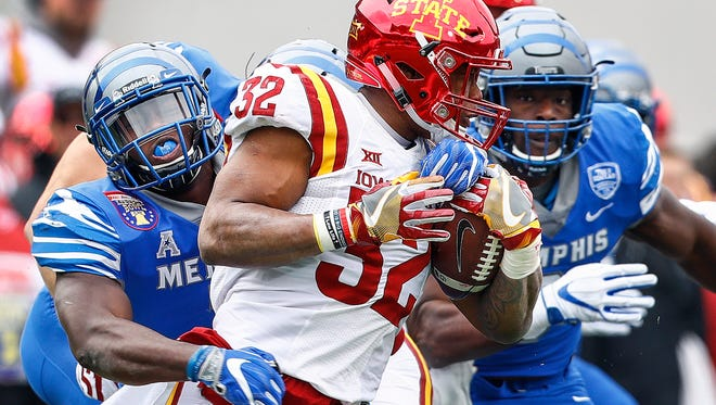 Memphis defender Curtis Akins (left) brings down during Iowa State running back David Montgomery (right) for a huge loss during first quarter action of the AutoZone Liberty Bowl in Memphis, Tenn., Saturday, December 30, 2017.