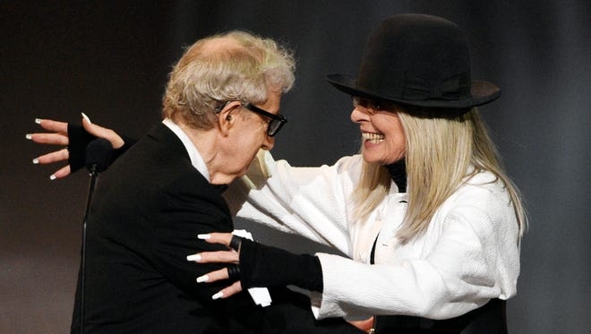 Filmmaker Woody Allen, left, greets actress Diane Keaton to present to her the 45th AFI Life Achievement Award during a gala tribute in Los Angeles in June 2017.