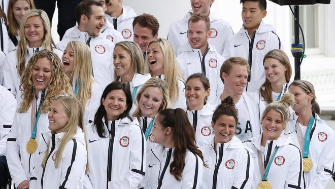 Members of the USA women's hockey team listen to U.S. President Donald Trump during a celebration of the USA 2018 Winter Olympic and Paralympic Teams on the North Portico of the White House on April 27, 2018 in Washington.