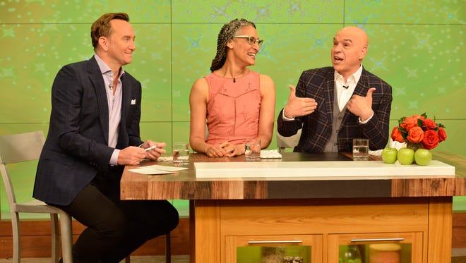 """Clinton Kelly, left, Carla Hall and Michael Symon are hosts of ABC's """"the Chew."""""""