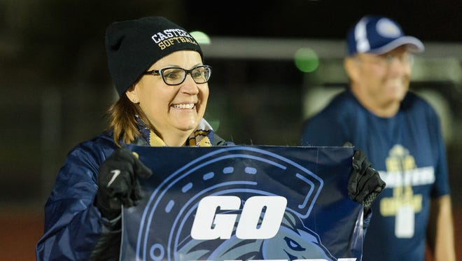 Casteel principal Sandy Lundberg cheers for her school in the fourth quarter the AIA Div 3A championship high school football game from the endzone on Saturday, Nov. 25, 2017, at Campo Verde High School in Gilbert, Ariz.