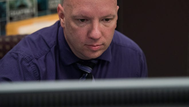 Montgomery Police Officer Bryan Goza, who is involved with sensitive investigations into child abuse cases, is shown at work on Wednesday July 18, 2018.