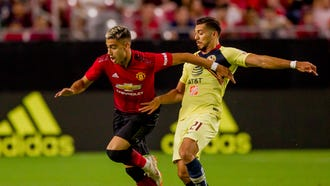 Manchester United forward Andreas Pereira (left) pushes past America forward Henry Martin for the ball on July 19, 2018, during Manchester United's matchup against Club America at the University of Phoenix Stadium in Glendale, Arizona.