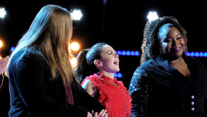 "Farmington's Chevel Shepherd, center, reacts after she was named one of the final eight contestants on ""The Voice"" during Tuesday's show."