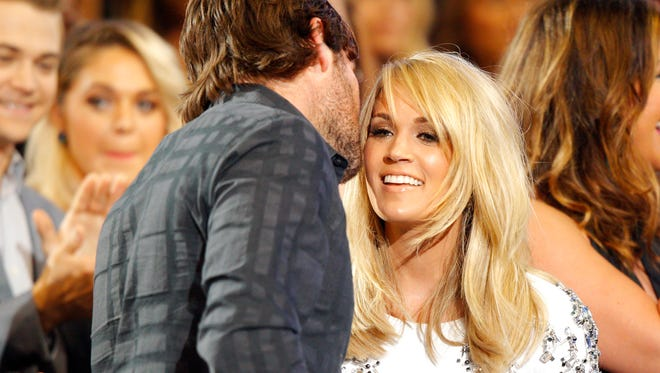 Carrie Underwood, right, and Mike Fisher attend the CMT Music Awards at Bridgestone Arena on Wednesday, June 10, 2015, in Nashville, Tenn.