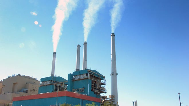 Smoke rises from a coal-burning power plant in in Colstrip, Mont.