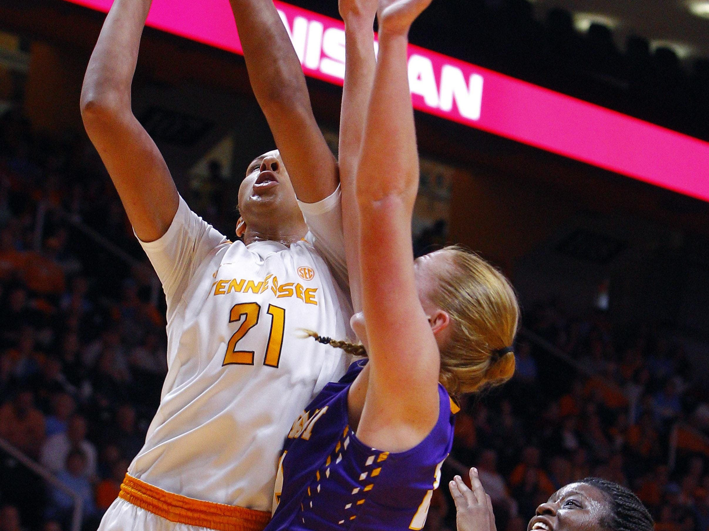 Tennessee center Mercedes Russell (21) shoots as she's defended by Albany forward Heather Forster (22) on Friday.