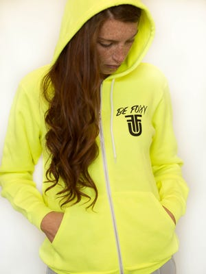 Former Marist College women's basketball star Rachele Fitz models one of the hooded sweatshirts from her new FitzU clothing line.