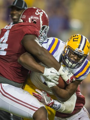 Tigers running back Leonard Fournette (7) is hit at the line of scrimmage by Alabama defensive lineman Dalvin Tomlinson (54) in Death Valley, November 5, 2016. BUDDY DELAHOUSSAYE/ THE ADVERTISER