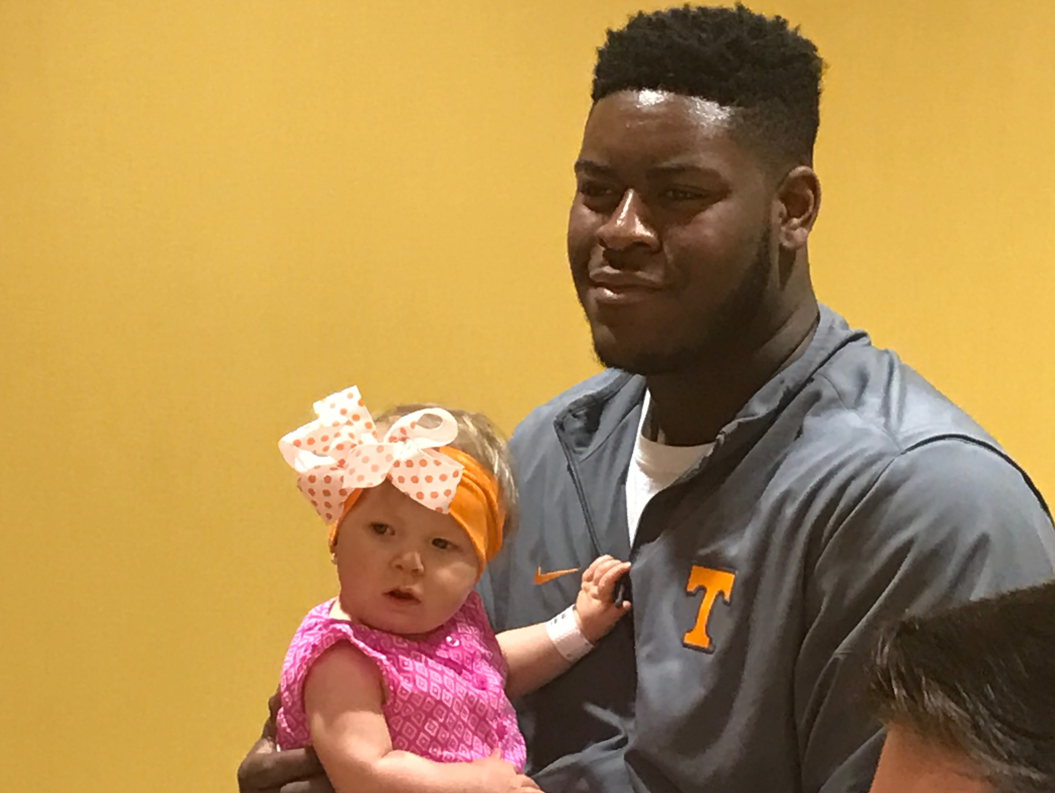 When the Vols visited East Tennessee Children's Hospital in March 2017, Trey Smith spent time holding Paizley Hatcher, a seven-month-old girl who spent her first three months in the neonatal intensive care unit. Afterwards he said the experience was humbling.