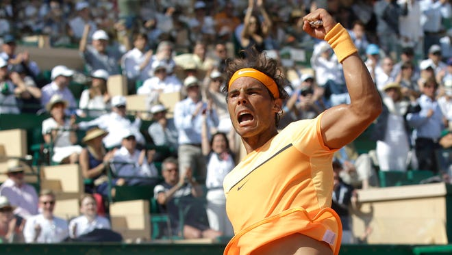 Nadal reacts after defeating  Andy Murray.
