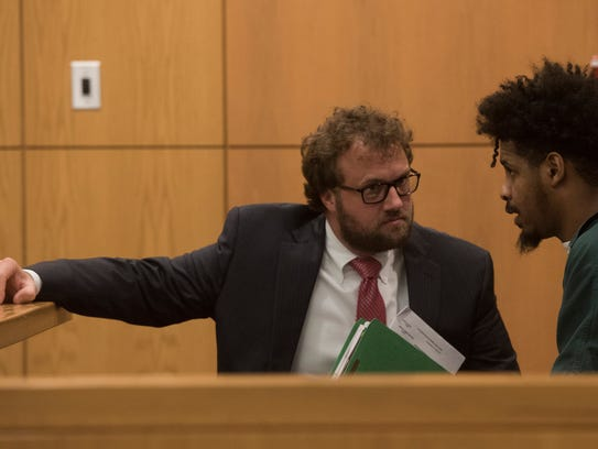 Demetric Milhouse, right, talks with attorney, Thomas