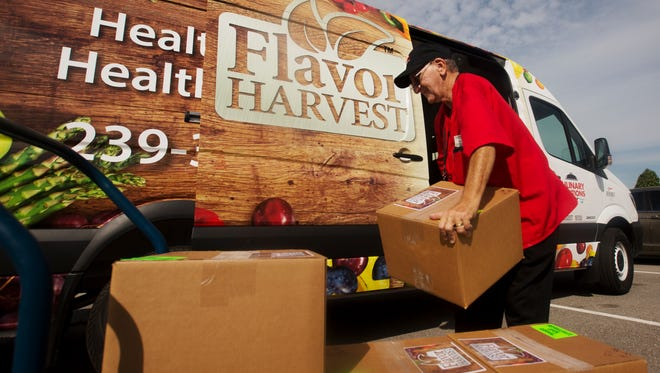 Paul Farraiolo, a driver for Flavor Harvest/Culinary Solutions with LeeSar loads healthy meals for recently released patients from Cape Coral Hospital.