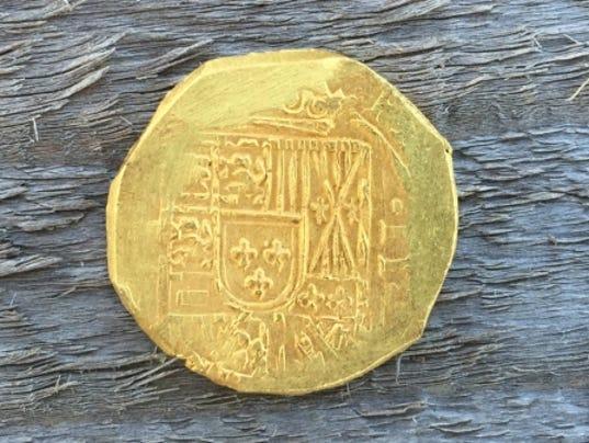636361431106519965-gold-coin-Capitana.jpg