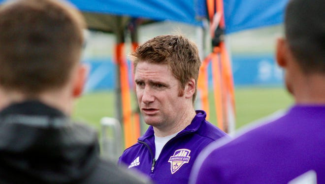 Louisville City FC coach James O'Connor addresses his team.