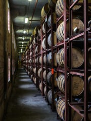 Rows of bourbon barrels age inside a Brown-Forman warehouse off Dixie Highway.