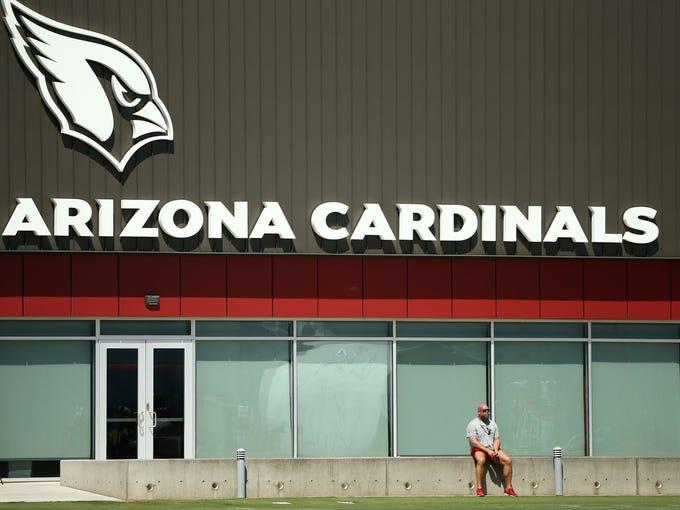 Arizona Cardinals GM Steve Keim watches practice on