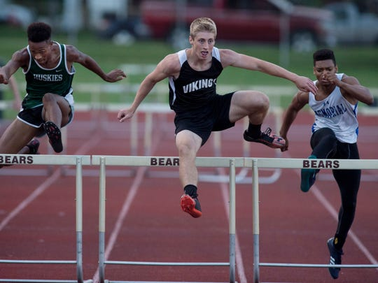 North Posey's Josh Wiggins heads for the finish line ahead of North's Nathaniel Jackson, left, and Memorial's Stacen Cunningham in the 300 meter hurdles at the IHSAA Central Boys Sectional Thursday evening. Wiggins won the event with a time of 39.75.