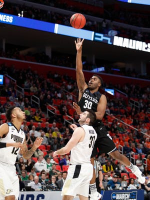 Bulldogs forward Kelan Martin (30) shoots in the second half against the Purdue Boilermakers in the second round of the 2018 NCAA Tournament at Little Caesars Arena.