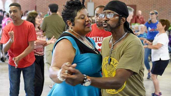 Couples dance to the music of Geno Delafose and French Rockin' Boogie May 4 during Music & Market at the Farmer's Market Pavilion in Opelousas.