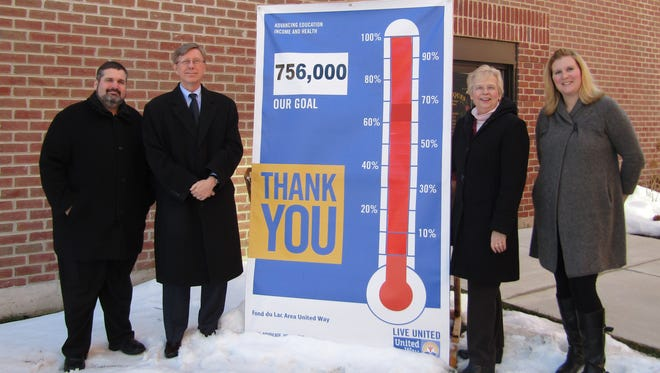 Fond du Lac Area United Way reached its campaign goal of $756,000. From left are Dave Hodorff, Brenner Tank (Senior Pacesetter), 2015 United Way Honorary Campaign Chair; Rick Parks, Society Insurance (Junior Pacesetter); Cathi McGowan, United Way Board president; Amber Kilawee, United Way executive director.