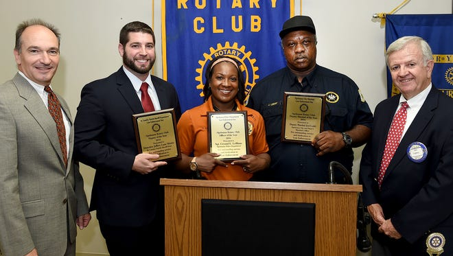 Three law enforcement officers were awarded the Opelousas Rotary Club's outstanding officer award during Law Enforcement Day ceremonies Tuesday. Pictured with club members Billy McCarthy, far left, and Jim Lopez, far right, are Detective Jeffery Lane MIstric, St. Landry Parish Sheriff's Department; Sgt. Crystal E. LeBlanc, Opelousas Police Department; and Deputy Marshal Joel Leday, Opelousas City Marshal's office. See more photos on Facebook.