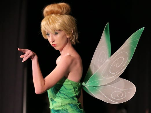 Caroline Simmel as Tinkerbell participates in the costume contest during Gen Con at the Indiana Convention Center Saturday, Aug. 16, 2014, in Indianapolis.