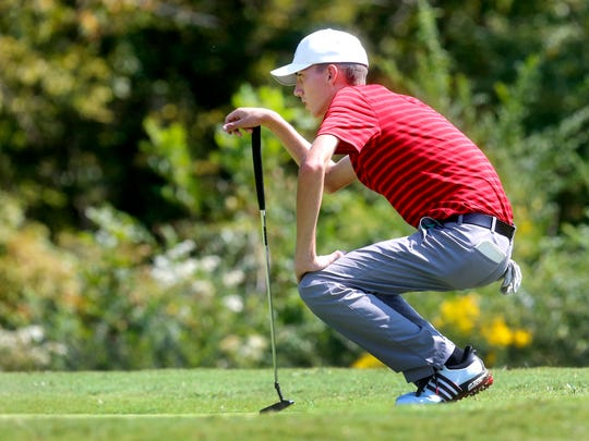 Stewarts Creek's Shelden Barina lines up his shot during the 7-AAA District Tournament, on Monday, Sept. 18, 2017, at Old Fort Park Golf Course.