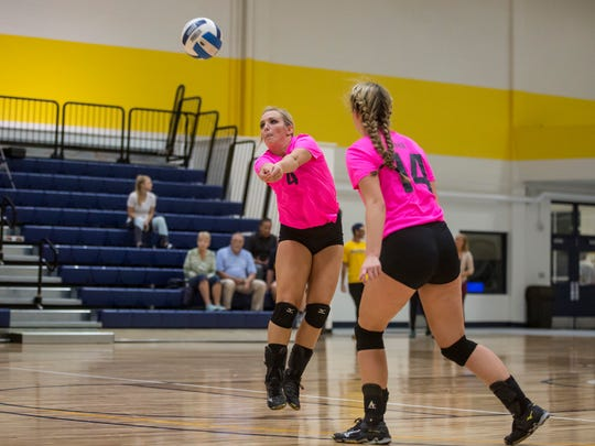 SC4's Caitlyn Carlson digs the ball during a volleyball game Tuesday, Oct. 18, 2016 at SC4 Fieldhouse in Port Huron.