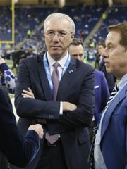 New Lions president Rod Wood, left, stands with vice chair Bill Ford Jr. on Thanksgiving.
