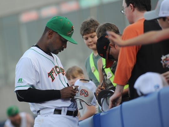 Norfolk Tides' L.J. Hoes signs autographs for fans before the start of the Tides game with the Scranton/Wilkes-Barre Railriders on Friday, May 27, 2016 in Norfolk, Va. Hoes spent time with the Delmarva Shorebirds before moving up to the Orioles AAA Norfolk team.