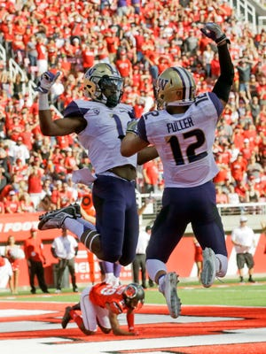 Washington's John Ross (1) celebrates with teammate Aaron Fuller (12) after catching a touchdown pass against Utah in the second half during an NCAA college football game, Saturday, Oct. 29, 2016, in Salt Lake City. Washington won 31-24. (AP Photo/Rick Bowmer)