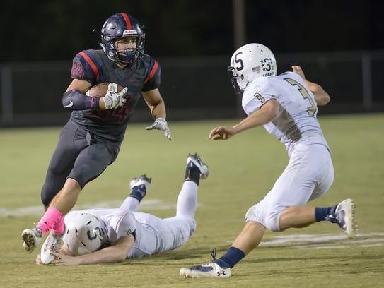 Creek Wood's Mitch Duke runs the football against Sycamore