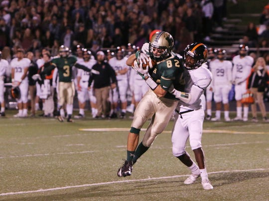 Howell's  Logan Russo caught six passes for 86 yards and two touchdowns in a 41-20 loss to Brighton.