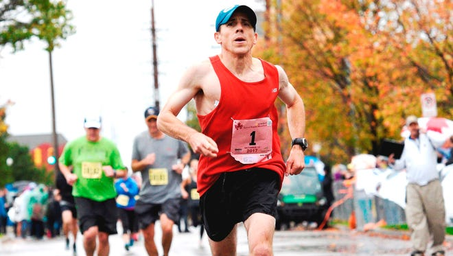 Novi assistant cross country coach Mike Camilleri repeated as the Grand Rapids Marathon champion.