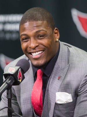 Adrian Wilson smiles answering questions about his retirement after signing a contract with the Cardinals at the Cardinals Training facility in Tempe, AZ on April 18, 2015.