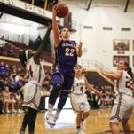 Waukee junior Callie Littlefield drives to the hoop against Lincoln on Tuesday, Dec. 1, 2015, at Lincoln High School in Des Moines.
