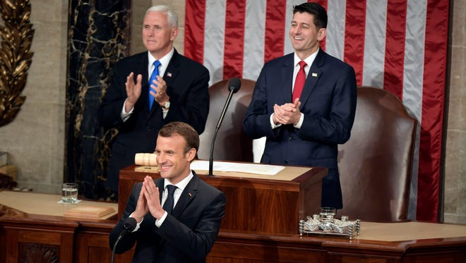 French President Emmanuel Macron addresses Congress during a joint meeting on April 25, 2018 in Washington. Vice President Mike Pence, left,  and House Speaker Paul D. Ryan (R-Wis.) appear behind Macron.