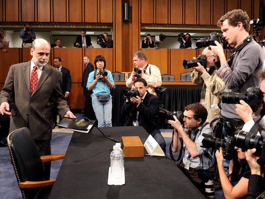 Federal Reserve Chairman Ben Bernanke arrives to testify