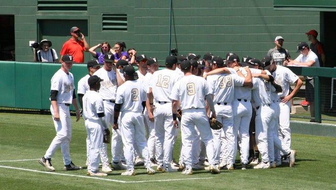 Vanderbilt players huddle around during a 13-4 win over St. John's in the Clemson Regional Friday.