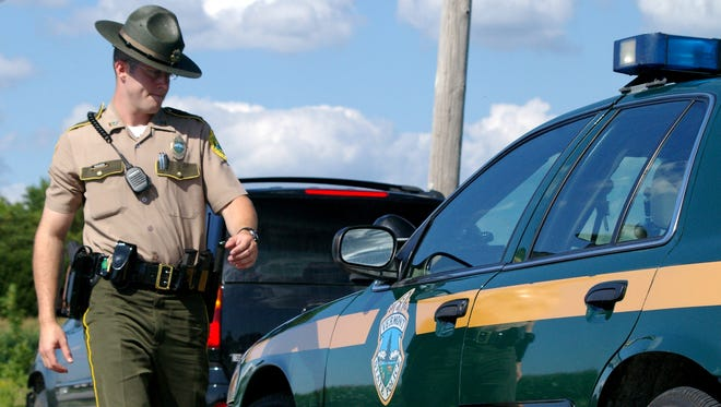 A Vermont state trooper makes a traffic stop in 2007.