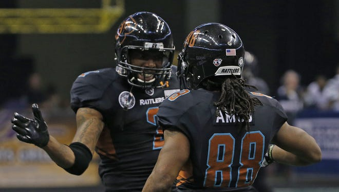 Rattlers' Maurice Purify (2) celebrates with Anthony Amos (88) after an Amos touchdown catch during the first round playoff game against the Steel at Talking Stick Resort Arena on August 6, 2016 in Phoenix, Ariz.