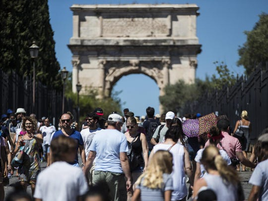 Tourists at the Colosseum on the eve of 'Ferragosto' in Rome, Italy,14 August 2017. Ferragosto is an Italian public holiday celebrated on 15 August, coinciding with the major Catholic feast of the Assumption of Mary. By metonymy, it is also the summer vacation period around mid-August, which may be a long weekend (ponte di ferragosto) or most of August.