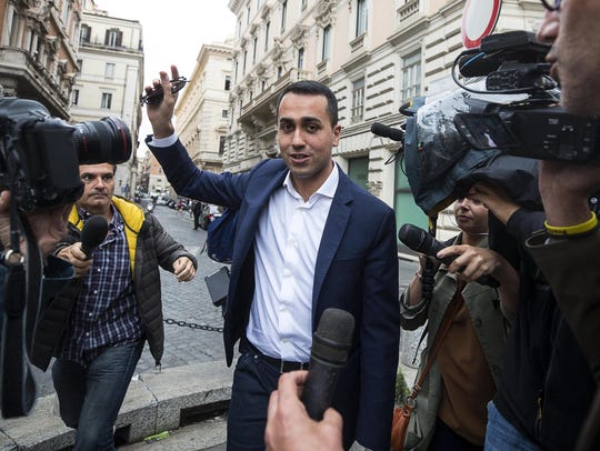 Five-Star Movement leader Luigi Di Maio talks to the