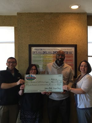 Patrick Ripberger (from left), Stacey Steele, Paul Stanley and Heather Buckland of Partnership for a Drug Free Wayne County hold a check for $51,970.50 representing the amount awarded during the non-profit's 2016 grant cycle.