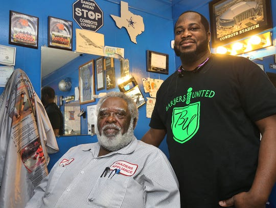 Master barber Eric Turner, right stands next to  James
