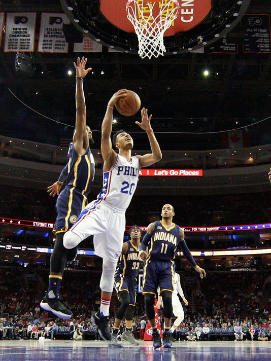 Philadelphia 76ers' Timothe Luwawu-Cabarrot, right, goes up for the shot as he gets past Indiana Pacers' Paul George, left, during the first half of an NBA basketball game, Monday, April 10, 2017, in Philadelphia. (AP Photo/Chris Szagola)