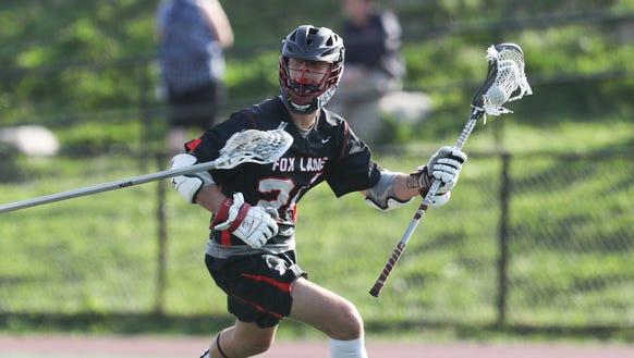 Fox Lane's Matt Magnan (24) in action during boys lacrosse