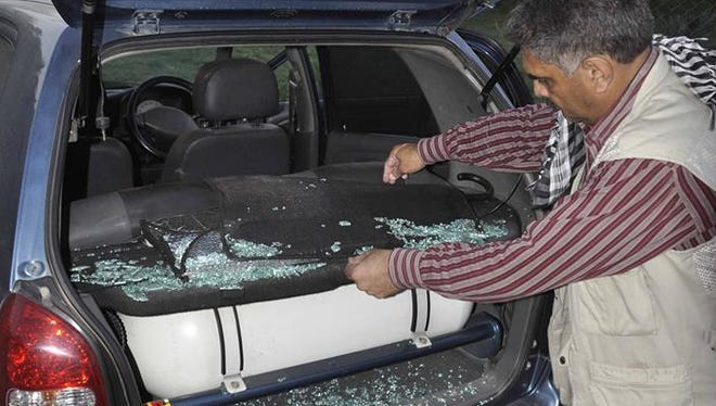The windows of the car owned by photo journalist Mazhar Khan, who has been covering the protests in Pakistan, were smashed out by anti-government protesters.