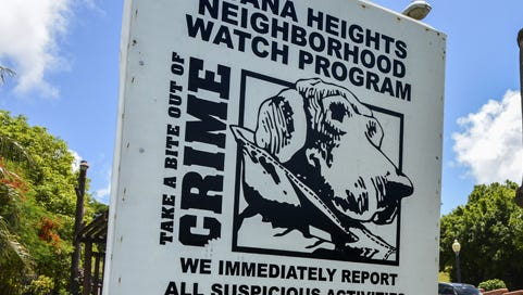 A neighborhood watch sign in Agana Heights.